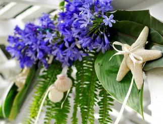 Blue wedding flowers and seashells
