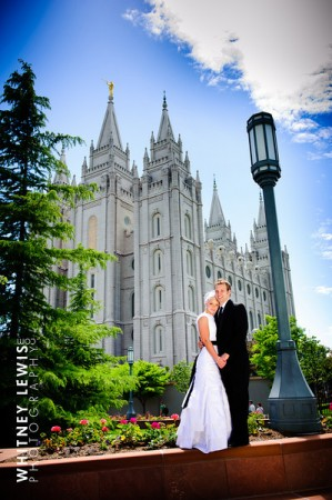 An LDS bride and groom in front of an LDS Temple