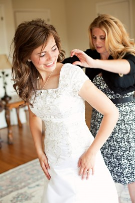 An LDS bride and her mom getting ready for an LDS wedding reception