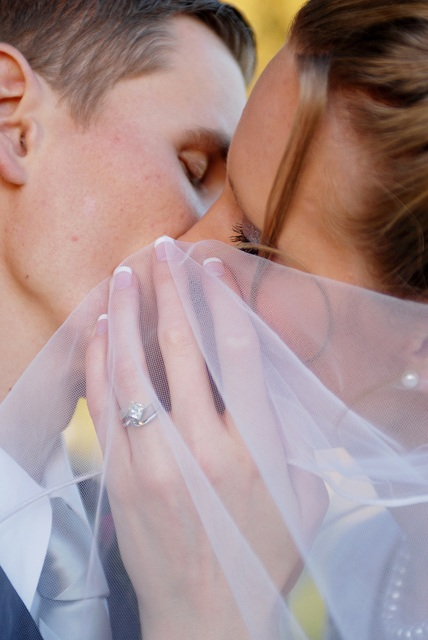 An LDS bride and groom show her ring