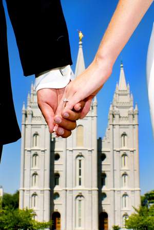 LDS bride and groom hold hands as they head to the LDS Temple