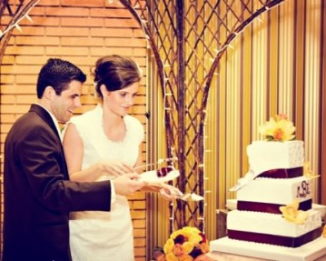 LDS Bride and Groom with the cake, Real Mormon wedding reception
