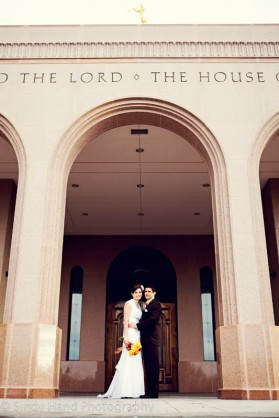 An LDS bride and groom in front of LDS temple