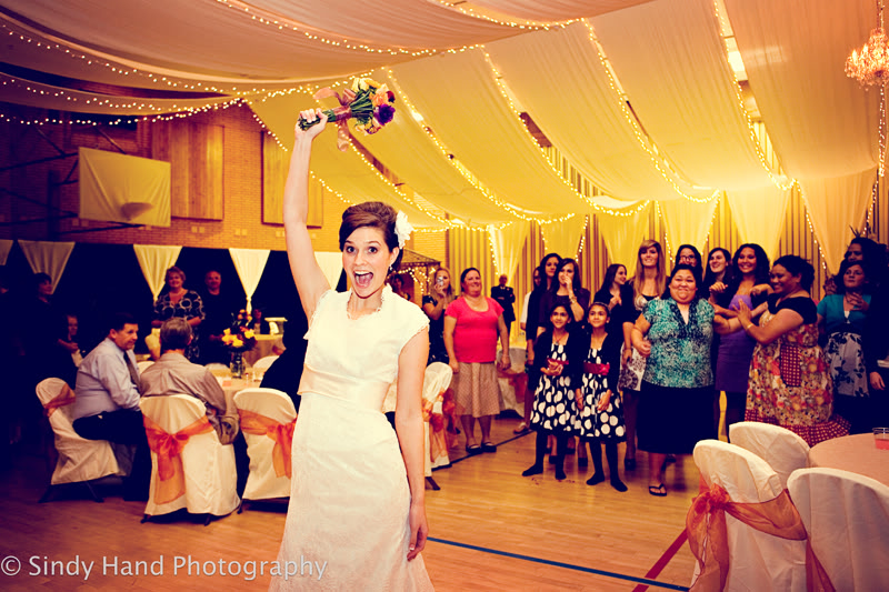 Bride tosses bouquet, Featured Real LDS Wedding Reception