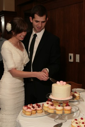 LDS bride and groom cutting wedding cake, LDS wedding, featured LDS wedding