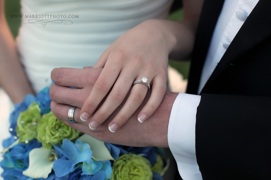 LDS bride and groom display their rings