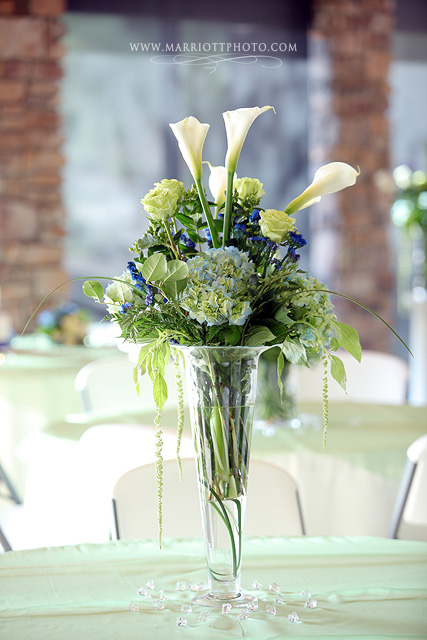 Elegant wedding centerpiece of wedding flowers in a vase