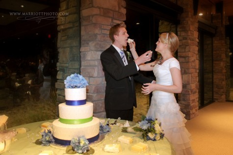 the first slice of wedding cake