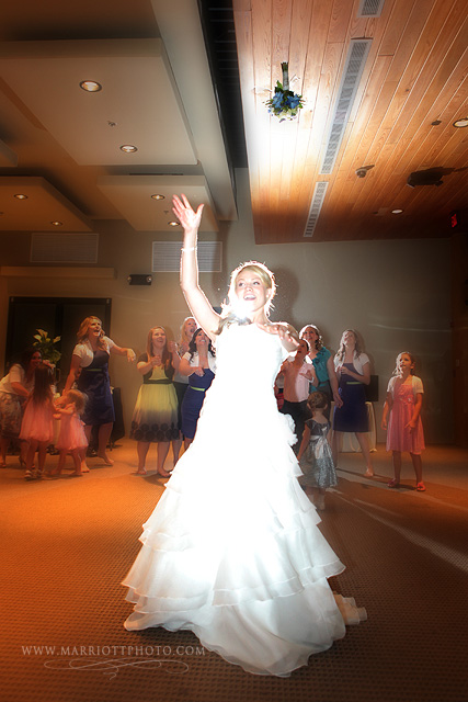 Featured Real LDS Wedding, a bride throws her bouquet