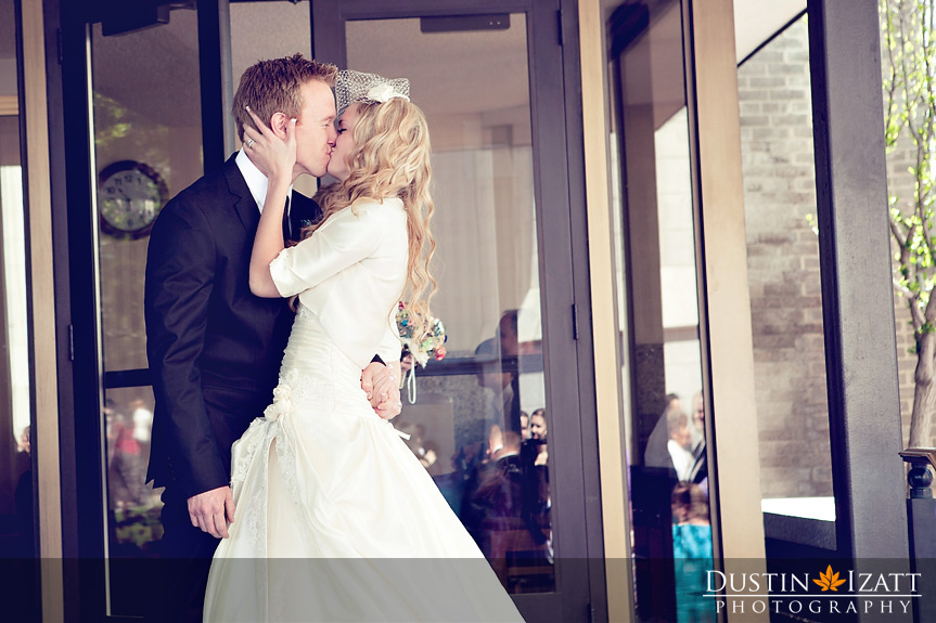 An LDS bride and groom kiss