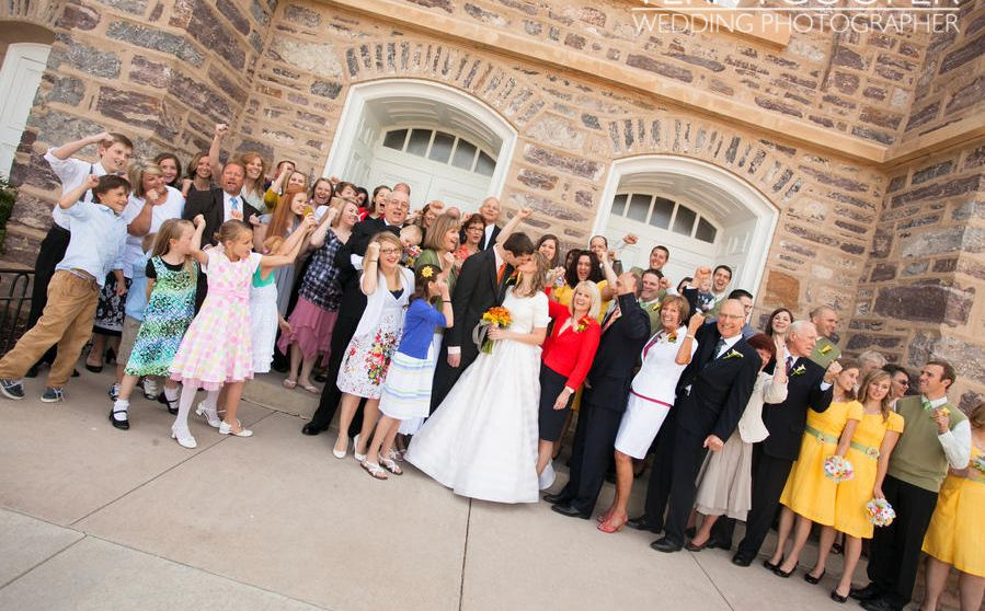 LDS bride and groom with their extended family