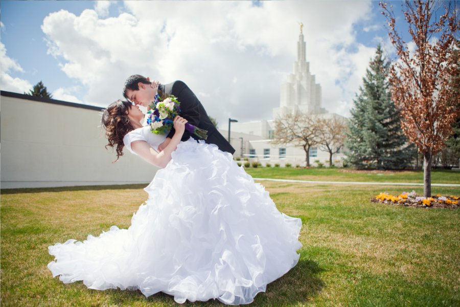 An LDS bride and groom share a moment outside the LDS Temple, WeddingLDS.com