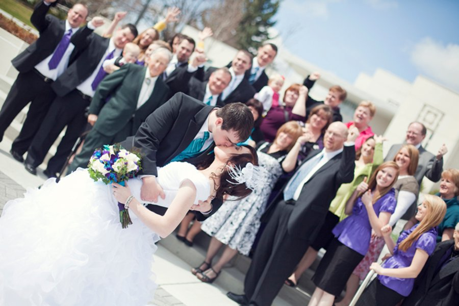 An LDS bride and groom share a kiss outside the LDS Temple, WeddingLDS.com